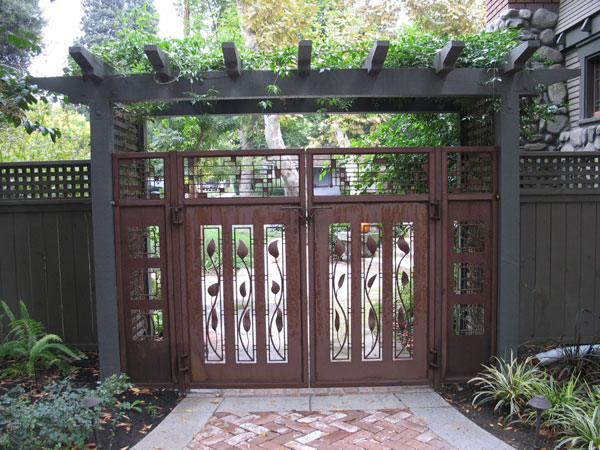 Romero metal sculpture gates artist dan romero works for Gate house designs